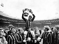 26th April 1969: The FA cup final at Wembley, Manchester City versus Leicester City..Photo shows: Captain, Tony Book holds aloft the trophy as he is chaired around Wembley Stadium by his team mates. (l-r) David Connor; Tommy Booth; Glyn Pardoe; Francis Lee; Mike Doyle (supporting Book on his shoulders), goalkeeper, Harry Dowd; Colin Bell and Alan Oakes.