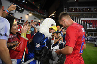 WASHINGTON, D.C. - OCTOBER 11: Tyler Boyd #21 of the United States signs autographs after their Nations League game versus Cuba at Audi Field, on October 11, 2019 in Washington D.C.