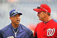 29 May 2011: San Diego Padres first base coach Dave Roberts chats with Washington Nationals' Manager Jim Riggleman prior to a game at Nationals Park in Washington, District of Columbia. The Padres defeated the Nationals 5-4 to take the rubber match of their 3-game series. Mandatory Credit: Ed Wolfstein Photo