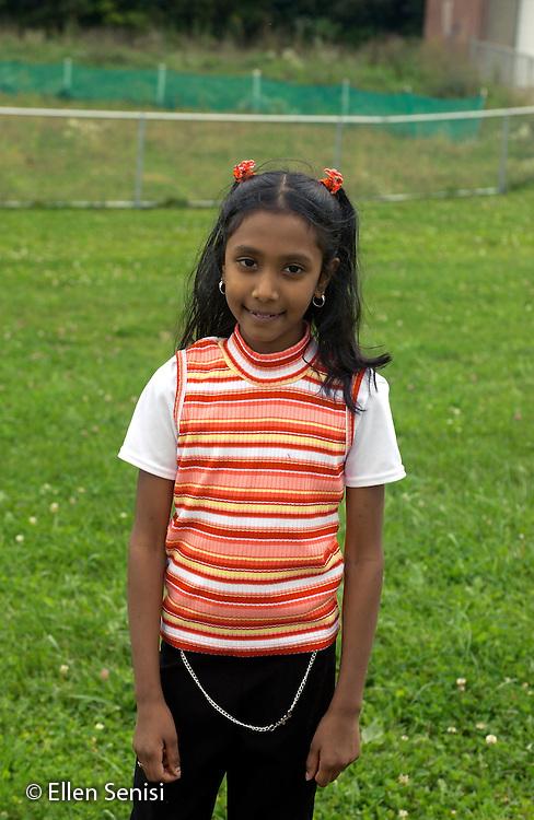 MR / Schenectady, NY.Yates Arts-in-Education Magnet School (urban public school)  .Girl (8, grade 3, Guyanese-American) on playground, smiling.     .MR: Poo1.©Ellen B. Senisi
