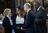 Chantal Renaud greets Djemila Benhabib, Daniel Amar and Maka Kotto, left to right, after addressing  funeral services for her husband, former Quebec premier Bernard Landry in Montreal on Tuesday, November 13, 2018. THE CANADIAN PRESS/Paul Chiasson