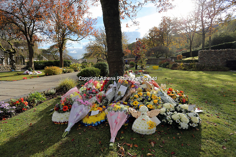 Pictured: Flowers left at the Memorial Garden Friday 21 October 2016<br />Re: Wales has fallen silent as the country remembered the Aberfan disaster 50 years ago.<br />On 21 October 1966, a mountain of coal waste slid down into a school and houses in the Welsh village, killing 144 people, including 116 children.<br />A day of events to commemorate the disaster included a service at Aberfan Cemetery at 9:15am on Friday.<br />Prince Charles is visiting Aberfan memorial garden before unveiling a plaque in memory of the victims.<br />He will also attend a reception with the families of some of those who lost their lives, before signing a book of remembrance.