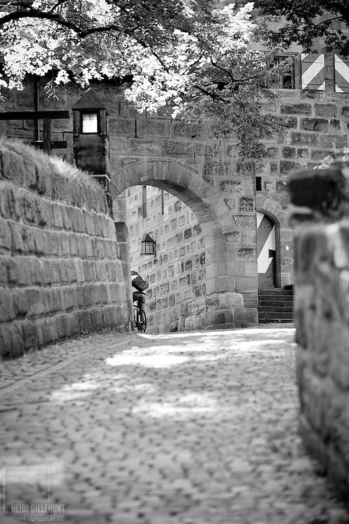 Bicyclist riding into Nurnberg Castle, Nurnberg, Germany