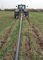Injecting sewage sludge in a stubble field on M. Miller's Greville Hall Farm, Evesham, Worcestershire.