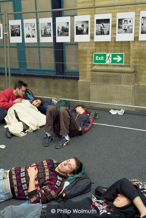 Delegates sleep at the back of a meeting hall at the European Social Forum in Alexandra Palace, London