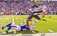 12 October 2014: New England Patriots tight end Rob Gronkowski is tackled by Buffalo Bills strong safety Duke Williams in an end-around play at Ralph Wilson Stadium in Orchard Park, NY. The Patriots defeated the Bills 37-22 to move into first place in the AFC Eastern Division. Mandatory Credit: Ed Wolfstein Photo *** RAW (NEF) Image File Available ***