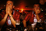 English football fans World Cup 1998. Supporters show their disappointment and disbelief at loosing to Argentina in a penalty shoot out. And thus getting knocked out of the World Cup. Sports Bar, London 1990s UK