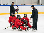 PyeongChang 8/3/2018 - Head Coach Ken Babey, of Saskatoon, SK, with Billy Bridges (#18), of Summerside, PEI, Ben Delaney(#10), of Ottawa, ON, and Dominic Cozzolino (#19), of Mississauga, ON, as Canada's sledge hockey team practices ahead of the start of competition at the Gangneung practice venue during the 2018 Winter Paralympic Games in Pyeongchang, Korea. Photo: Dave Holland/Canadian Paralympic Committee
