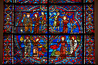 Medieval stained glass Window of the Gothic Cathedral of Chartres, France - dedicated to St Margret and St Catherine. Bottom left panel  - St Margaret vanquishing a demon, bottom  right panel - St Margaret bursting out of the belly of a dragon . Top left panel - The Prefect, Olibrius, condemns Margaret to death , top right panel - Martyrdom of St Margaret.  A UNESCO World Heritage Site.
