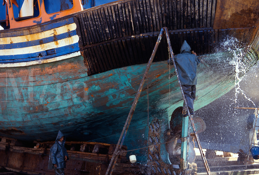 Dry docked boat being cleaned and repaired, Essouria, Morocco