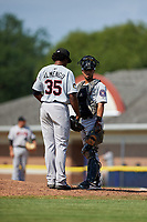 Tri-City ValleyCats catcher Carlos Canelon (1) talks with relief pitcher Diogenes Almengo (35) on the mound during a game against the Batavia Muckdogs on July 16, 2017 at Dwyer Stadium in Batavia, New York.  Tri-City defeated Batavia 13-8.  (Mike Janes/Four Seam Images)