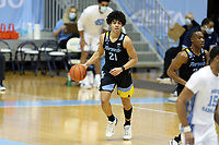 CHAPEL HILL, NC - FEBRUARY 24: D.J. Carton #21 of Marquette brings the ball up the court during a game between Marquette and North Carolina at Dean E. Smith Center on February 24, 2021 in Chapel Hill, North Carolina.