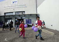 Pictured: Young migrant children with balloons at the port Monday 08 Fabruary 2016<br /> Re: Migrants wait in the Piraeus passenger station to be transported to the migrants' camp in Elliniko, Athens, Greece