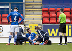St Johnstone v Livingston…15.05.21  SPFL McDiarmid Park<br />Callum Booth is treated by physio Mel Stewart<br />Picture by Graeme Hart.<br />Copyright Perthshire Picture Agency<br />Tel: 01738 623350  Mobile: 07990 594431