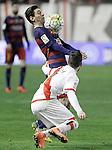 Rayo Vallecano's Tito Roman (d) and FC Barcelona's Leo Messi during La Liga match. March 3,2016. (ALTERPHOTOS/Acero)