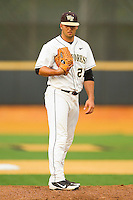 Wake Forest Demon Deacons relief pitcher Niko Spezial #27 looks to his catcher for the sign against the Elon Phoenix at Wake Forest Baseball Park on May 1, 2012 in Winston-Salem, North Carolina.  The Demon Deacons defeated the Phoenix 7-5.  (Brian Westerholt/Four Seam Images)