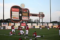 Nashville Sounds players warmup in front of the scoreboard before a game against the Omaha Storm Chasers at Greer Stadium on April 25, 2011 in Nashville, Tennessee.  Omaha defeated Nashville 2-1.  Photo By Mike Janes/Four Seam Images