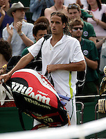 28-6-06,England, London, Wimbledon, first round match,  Lopez