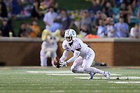 WINSTON-SALEM, NC - SEPTEMBER 13: Myles Dorn #1 of the University of North Carolina catches an interception during a game between University of North Carolina and Wake Forest University at BB