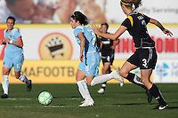 Sarah Walsh (left) of Sky Blue dribbles past Allison Falk (right) of the LA Sol in Sky Blue's home opener on Sunday, April 5, 2009 in Bridgewater, NJ.  The LA Sol defeated Sky Blue, 2-0.. Los Angeles Sol defeated Sky Blue 2-0 in Bridgewater, NJ on Sunday, April 5, 2009. Photo by Robyn McNeil/isiphotos.com