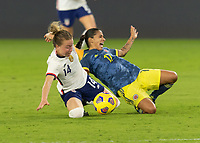 ORLANDO, FL - JANUARY 22: Emily Sonnett #14 knocks down Carolina Arias #17 to win possession during a game between Colombia and USWNT at Exploria stadium on January 22, 2021 in Orlando, Florida.