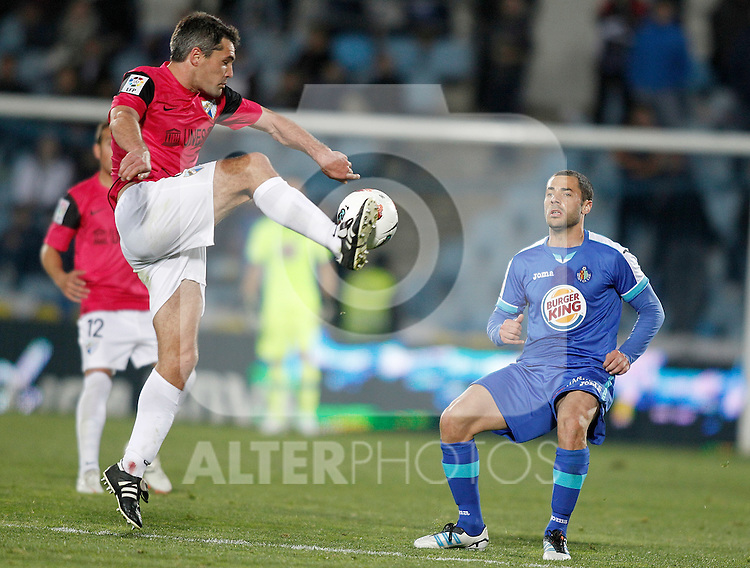 Getafe's Mehdi Lacen against Malaga's Jeremy Toulalan during La Liga Match. March 03, 2012. (ALTERPHOTOS/Alvaro Hernandez)