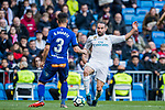Daniel Carvajal Ramos (R) of Real Madrid fights for the ball with Ruben Duarte of Deportivo Alaves during the La Liga 2017-18 match between Real Madrid and Deportivo Alaves at Santiago Bernabeu Stadium on February 24 2018 in Madrid, Spain. Photo by Diego Souto / Power Sport Images