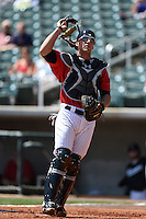 Birmingham Barons catcher Kevan Smith (32) looks for a pop up foul ball during a game against the Tennessee Smokies on April 21, 2014 at Regions Field in Birmingham, Alabama.  Tennessee defeated Birmingham 10-5.  (Mike Janes/Four Seam Images)