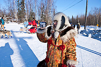 Rookie Middie Johnson of Unalakleet goes to park his team as his wife, Anausuk, takes video footage of him at the Galena checkpoint during the 2010 Iditarod