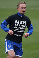 Kyle Dempsey of Gillingham wears a T-shirt with the words Men taking action against violence towards women during Gillingham vs Exeter City, Emirates FA Cup Football at the MEMS Priestfield Stadium on 28th November 2020