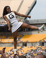 A Grambling State cheerleader does a balancing act during a football game between the Grambling State Tigers and the Pitt Panthers at Heinz Field, Pittsburgh, Pennsylvania on September 08, 2007.