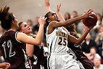Waterbury, CT- 30, December 2010-123010CM14 Holy Cross' Briana Bradford drives to the hoop through Torrington's Taylor Christiano (#12) Alyssa Otis ((behind) and Morgan Thulin (right) Thursday night in Waterbury. Holy Cross defeated Torrington, 50-44 to remain undefeated on the season. Christopher Massa Republican-American