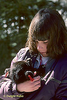 MA01-053z  Black Bear - girl holding tagged cub removed by biologists from winter den - Ursus americanus
