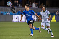 SAN JOSE, CA - MAY 15: Shea Salinas #6 of the San Jose Earthquakes chases the ball ahead of Renzo Zambrano #40 of the Portland Timbers during a game between San Jose Earthquakes and Portland Timbers at PayPal Park on May 15, 2021 in San Jose, California.