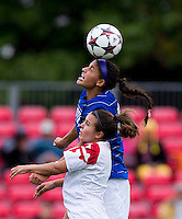Aubrey Baker (3) of Maryland goes up for a header with Kim DeCesare (19) of Duke at Ludwig Field on the campus of the University of Maryland in College Park, MD. DC. Duke defeated Maryland, 2-1.