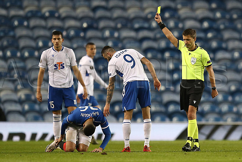 29th October 2020, Ibrox Stadium, Glasgow, Scotland; UEFA Europa League football, group stages; Glasgow Rangers versus Lech Poznan;   Mikael Ishak of Lech Poznan is shown a yellow card