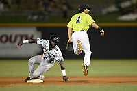 Second baseman J.J. Franco (2) of the Columbia Fireflies puts out Jacob Heyward (10) of the Augusta GreenJackets as he turns a double play on Saturday, July 29, 2017, at Spirit Communications Park in Columbia, South Carolina. Columbia won, 3-0. (Tom Priddy/Four Seam Images)