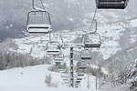 Covid-19 Pandemic - Ski Resorts Closed. Panarotta, Italy on December 7, 2020. Ski Resorts remain closed in Italy and in most part of Europe till 7th of January to avoid the spread of the Novel Coronavirus. Chairlift and snow cannon stopped under the snow.