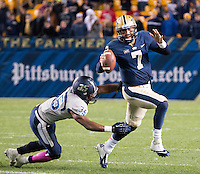 Pitt quarterback Tom Savage (7) escapes from Old Dominion linebacker Anthony Wilson (35). The Pitt Panthers defeated the Old Dominion Monarchs 35-24 at Heinz Field, Pittsburgh, Pennsylvania on October 19, 2013.