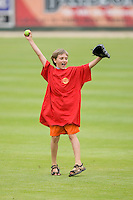 """A young fan celebrates after competing in the """"catch a fly"""" contest at Fieldcrest Cannon Stadium April 14, 2010, in Kannapolis, North Carolina.  Photo by Brian Westerholt / Four Seam Images"""
