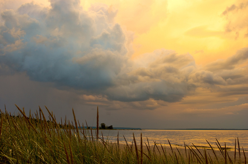 A summer thunderstorm passing over this Lake Michigan beach. Located in Nahma, MI.