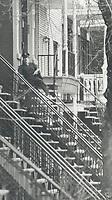 1979 FILE PHOTO - ARCHIVES -<br /> <br /> Montréal's Postman negotiates iron railings<br /> <br /> Bezant, Graham<br /> Picture, 1979<br /> <br /> 1979,<br /> <br /> PHOTO : Graham Bezant - Toronto Star Archives - AQP