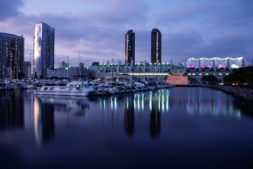The San Diego skyline and Convention Center reflected upon the waterfront at dusk. San Diego, California.