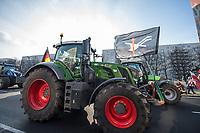 """Mehrere hundert Bauern, hautsaechlich aus Niedersachsen und Schleswig-Holstein, demonstrierten am Dienstag den 26. Januar 2021 in Berlin mit ihren Traktoren gegen die Agrar-Politik der Bundesregierung. Sie fordern 80 Prozent deutsche Landwirtschaftsprodukte in den Lebensmittelgeschaeften und dass dort nur  auslaendische Lebensmittel zugelassen werden, welche nach deutschen Produktionsstandards erzeugt wurden.<br /> An einem Grossteil der Traktoren waren Fahnen der norddeutschen sog. """"Landvolkbewegung"""" (schwarze Fahne mit einem stilisierten Pflug und einem roten Schwert) von 1929 angebracht. Mitglieder der national-voelkischen und antisemitischen """"Landvolkbewegung"""" veruebten Anschlaege auf anders gesinnte Bauern, auf Landrats- und Finanzaemter sowie Privathaeuser von Regierungsbeamten. Seit dem Ende des Nationalsozialismus 1945 nutzen Alt- und Neonazis den Namen und das Symbol.<br /> Aufgerufen zu der Demonstration hatte die Organisation """"Land schafft Verbindung"""". Die Bauern wollen bis zum 31. Januar in Berlin bleiben.<br /> 26.1.2021, Berlin<br /> Copyright: Christian-Ditsch.de"""