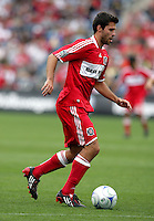 Chicago Fire midfielder Peter Lowry (29) dribbles the ball.  The Columbus Crew tied the Chicago Fire 2-2 at Toyota Park in Bridgeview, IL on September 20, 2009.