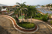 A picturesque road winds its way toward Marina Ixtapa, part of the master-planned resort community. (taken August 2007).  Photo by Patrick Schneider Photo.com
