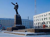 Workers clean snow around the Vladimir Lenin sculpture on Lenin Square in Yakutsk.