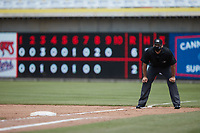 Umpire Macon Hammond handles the calls on the bases during the game between the Carolina Mudcats and the Kannapolis Cannon Ballers at Atrium Health Ballpark on June 13, 2021 in Kannapolis, North Carolina. (Brian Westerholt/Four Seam Images)