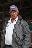 Cuba, Havana. Afro-Cuban Man, a Security Guard at Handicrafts Display Warehouse.