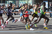 NEW YORK - NOVEMBER 7: The lead group of professional men, led by Haile Gebrselassie of Ethiopia, approaches the 8 mile mark on 4th avenue in the 2010 New York City Marathon.  Gebrselassie was forced to abandon the race at the 16 mile mark due to a knee injury.